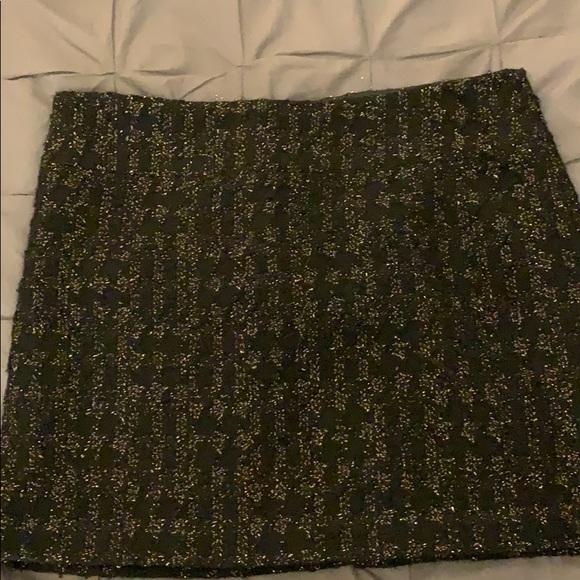 Calvin Klein Dresses & Skirts - Calvin Klein black & gold lined, wool mini skirt.